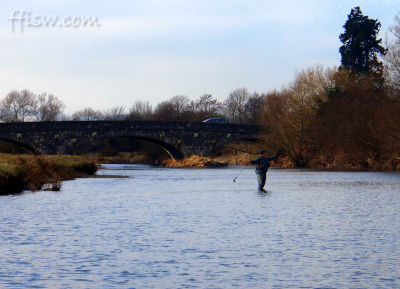 ...and busy de-icing his rod-rings after catching a fish.