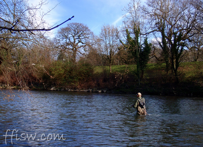 Early spring sun, and Rob fishes a great looking stretch...